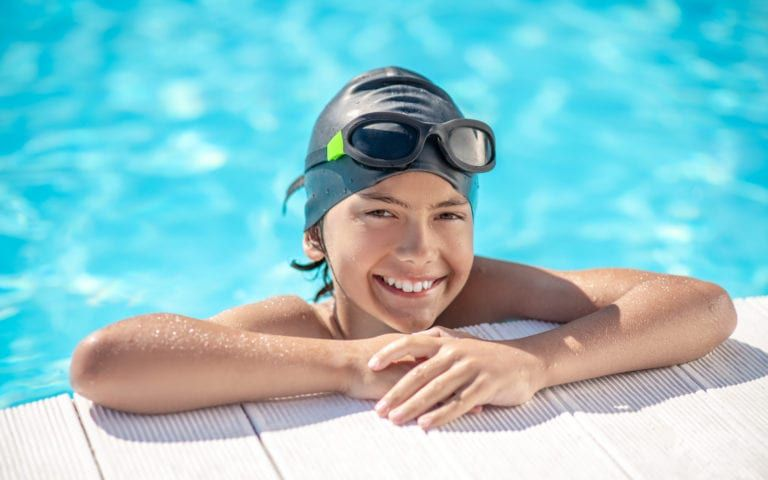 Child smiling in pool