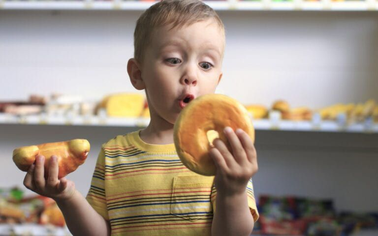 Child looking at Bagel excitedly