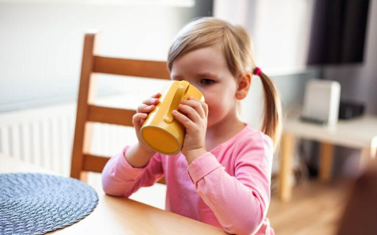 Child drinking a tooth healthy drink